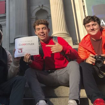 AP Art Trip Boys on Met stairs with sign